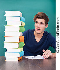 Shocked Student Looking At Books
