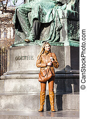 woman standing by Johann Wolfgang Goethe''s statue, Vienna,...