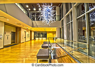 building interior with glass art piece suspended - building...