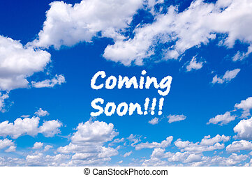 Coming soon sign clouds on the clear blue sky