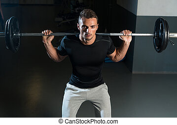 Barbell Squat - Young Athlete Doing Barbell Squats