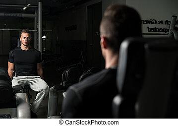 Shoulder Press Exercise - Young Men Doing Shoulder Press...
