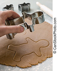 Cutting out a Gingerbread Man