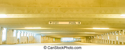underground parking structure early in the morning without...