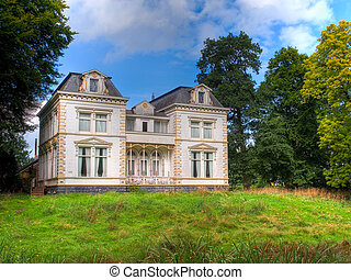 Historic White Mansion in Green Countryside