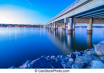 bridge over lake wylie - auto traffic bridge connecting land...