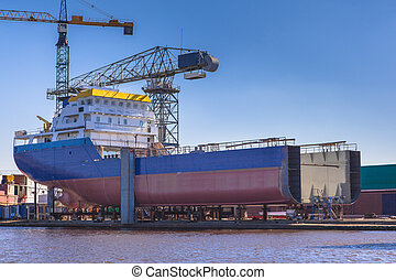 Ship Construction - Ship Being Constructed on a Wharf in the...