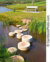 Step stones over water - Stepping Stones in Water of a Pond