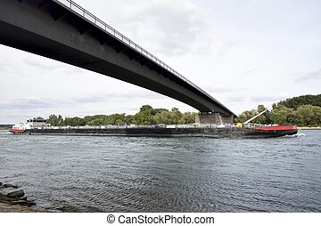 Transport Ship - Transport ship under a bridge accross the...