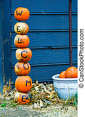 pumpkins welcome sign decorations during holidays at farm
