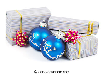 Christmas gifts and blue balls isolated on white