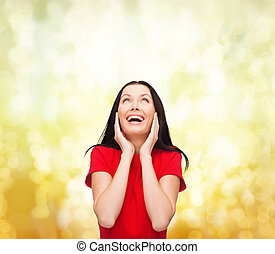 amazed laughing young woman in red dress - happiness and...