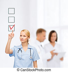 smiling doctor or nurse pointing to checkmark - healthcare,...