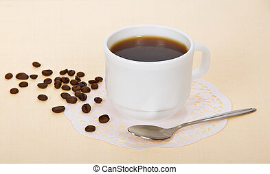 Cup of coffee - The cup of coffee on a beige background