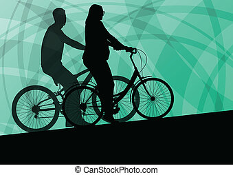 Active young family cyclists bicycle riders active sport...