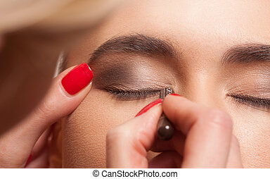 Model having eye makeup applied - Close up view of the eye...