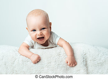 Little infant is smiling on the carpet - Little baby is...
