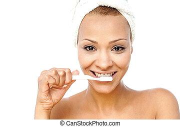 Smiling woman brushing her teeth - Gorgeous woman brushing...