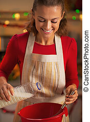 Happy young housewife preparing christmas dinner