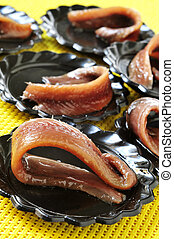 spanish anchovies served as appetizer - closeup of a plate...