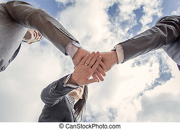 Business team showing unity with hands together - Bottom...