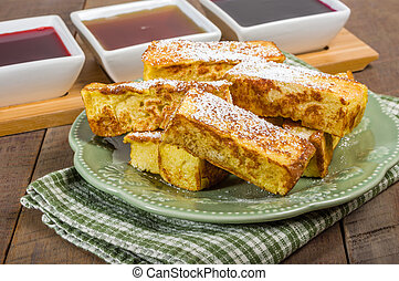 French toast sticks with syrups for dipping