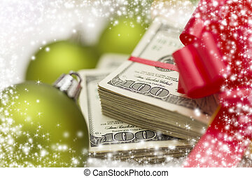 Stack of Hundred Dollar Bills with Bow Near Christmas...