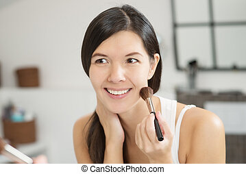 Attractiv happy woman applying makeup - Attractive smiling...