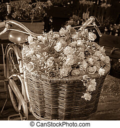 Flower on bike - Vintage bicycle has beautiful flowers in a...