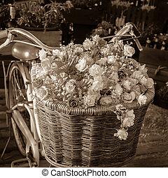 Flower on bike - Vintage bicycle has beautiful flowers in a...