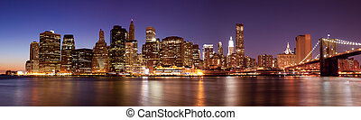 New York - Panoramic view of Manhattan Skyline by night -...