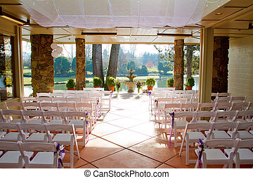 Indoor Wedding Venue - Chairs are lined up and ready for...