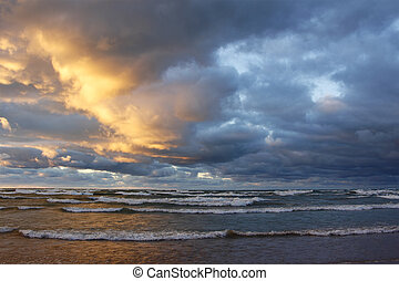 Storm Clouds Over a Beach at Sunset