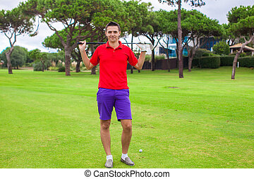 Young man on the golf course