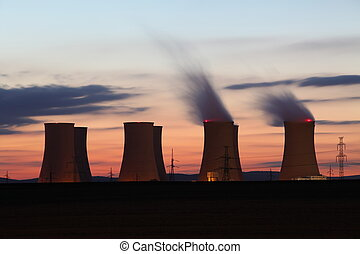 Nuclear power plant by sunset