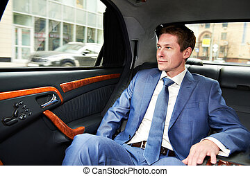 Business man in car - Business man goes to the executive car
