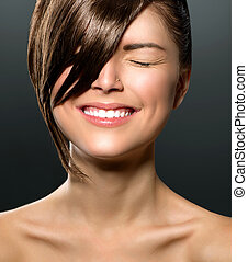 Laughing Teenage Girl with Closed Eyes. Stylish Fringe