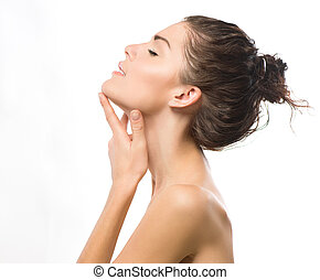 Beauty Portrait. Beautiful Spa Girl Touching her Face