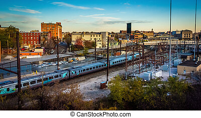 View of train tracks and an industrial area in Baltimore,...