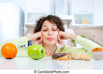 Dieting concept Young Woman choosing between Fruits and...