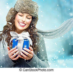 Beautiful Young Woman with Christmas Gift Box. Surprised...