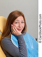 Dental fear - Portrait of a beautiful young woman at a...