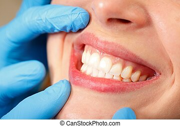 Beautiful smile - Patient at a dental clinic with a...