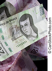 Mexican Money - Close up shot of mexican currency over black...