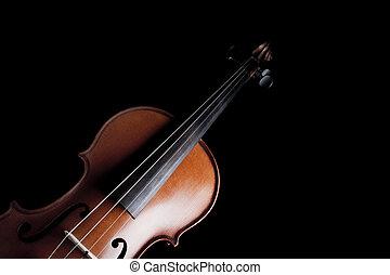 Violin - Medium shot of violin over dark background