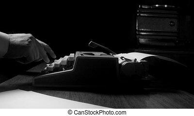 manual vintage typewriter - Journalist typing on a manual...