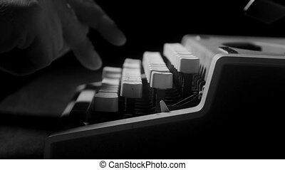 Male hands typing on a typewriter - Male hands typing on a...