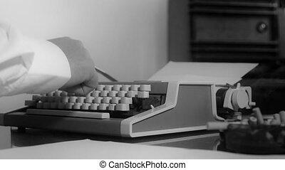 typing on a portable typewriter - Smoking journalist typing...