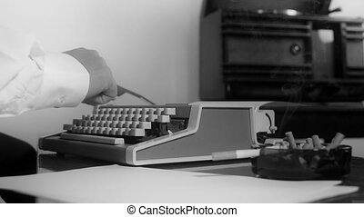 typing on a vintage typewriter - Smoking reporter typing on...