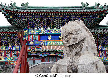 Stone Guardian Lion Statue in Beihai Park -- is an imperial garden to the northwest of the Forbidden City in Beijing, China